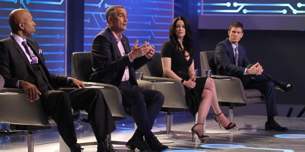"Sports legend and entrepreneur Kenny Smith (from left), Intel CEO Brian Krzanich, financial expert Carol Roth and co-host of truTV's ""Hack My Life"" Kevin Pereira are shown on the set of the first episode of ""America's Greatest Makers."" The show -- a collaboration between Intel, Mark Burnett (""Shark Tank,"" ""Survivor"") and Turner -- will premiere on TBS on Tuesday, April 5, 2016, with the presentation of the first 12 of 24 inventors who compete for the $1million grand prize. (Credit: Tommy Baynard)"