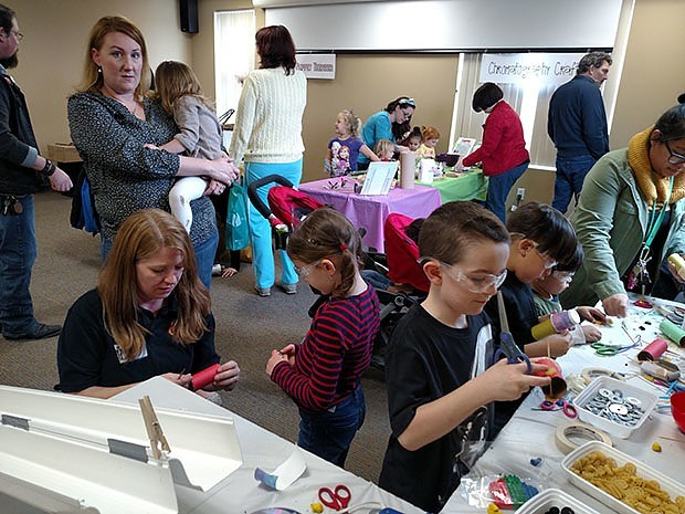 Children and parents built mini cars to compete on a rain gutter race track at this Nerdy Derby. Photo credit: Kelly Durkin