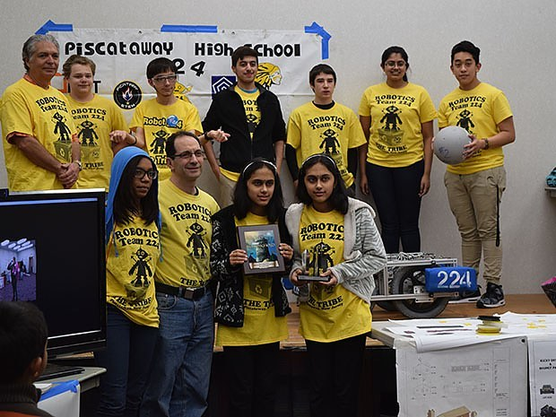 """Like many other high school robotics teams, Piscataway High School Team 224, """"The Tribe,"""" brought their competition robot to share with the public. Photo credit: Doug Baldwin"""