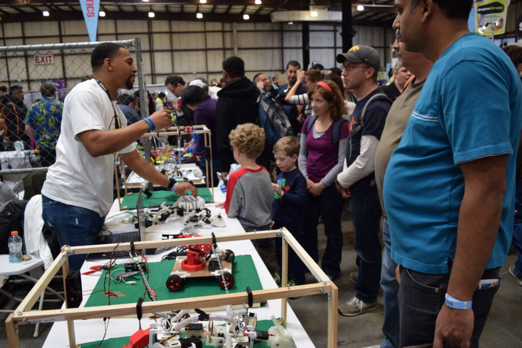 Jeffrey Moore explaining the Animech Project at Maker Faire. Photo courtesy of Jeffrey Moore