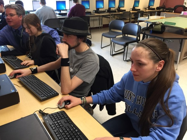 William LaBaire helping his Computer Science students with their programming techniques