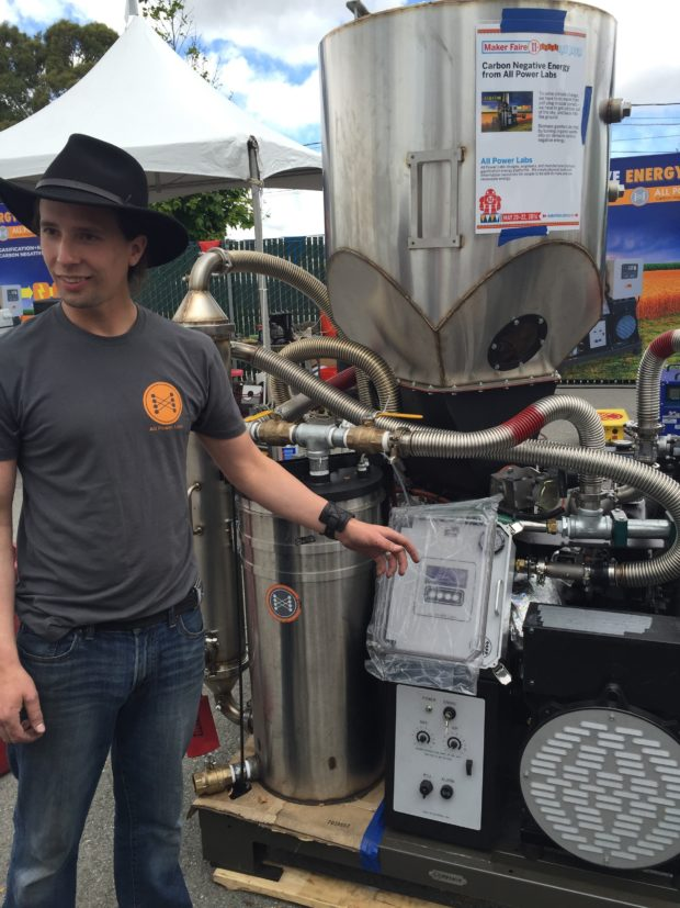 """Reverse global warming: This biomass gasifier burns agricultural waste (like wood chips or nut shells) to produce electricity and """"biochar"""" charcoal (carbon) that's buried in the ground, not released into the atmosphere as CO2. Carbon-negative power from All Power Labs of Berkeley,California (Keith Hammond,"""