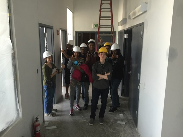 Tour of Baltimore Design School architecture-track students. We did five hardhat tours over the course of development so students could learn about trades and construction. Photo by Will Holman.