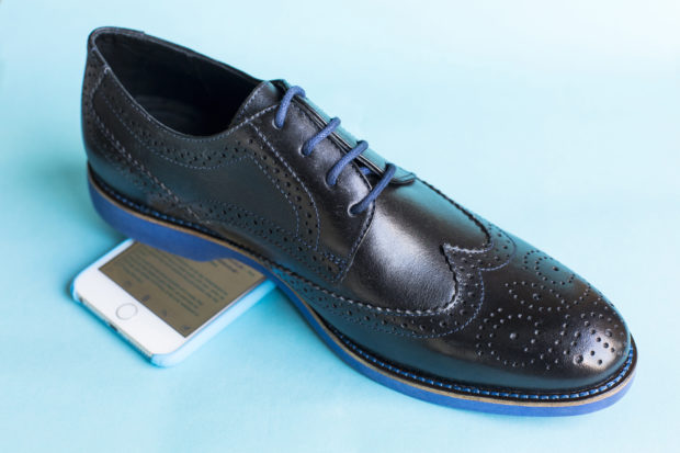 Hidden inside one of the shoes' rubber soles is an RFDuino module that connects to user's smartphones via a Bluetooth connection.