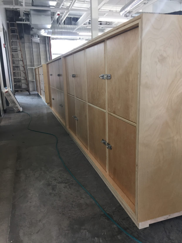 Storage lockers going into co-working areas. Photo by Will Holman