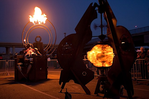 Moloch the Fire Demon gazing towards the Oscillation fire zoetrope at the Crucible's 2009 Fire Arts Festival in Oakland, California. Photo by Lois