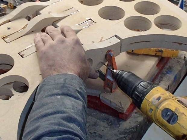 FIGURE 1-26: The pre-drilled hole will make it possible for the screw to effortlessly penetrate the MDF without splitting it apart.