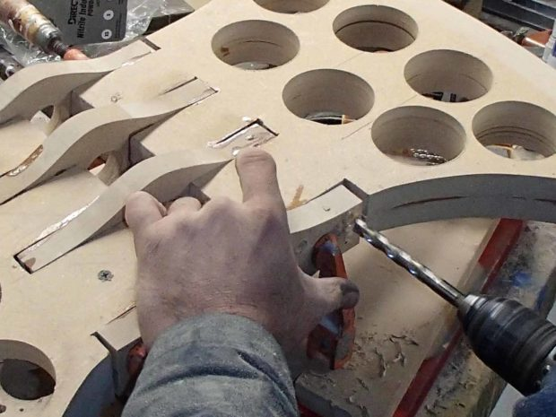"""FIGURE 1-27: Making a bigger hole for the screw head to hide in is called """"countersinking."""""""