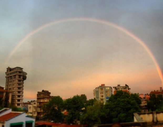 A rainbow over the city, as seen from a rooftop at Nepal Communitere.