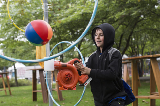 Kids achieve victory by using a modified leaf blower to hover a beach ball through a series of hula hoops. (Sunday, Andrew Kelly)