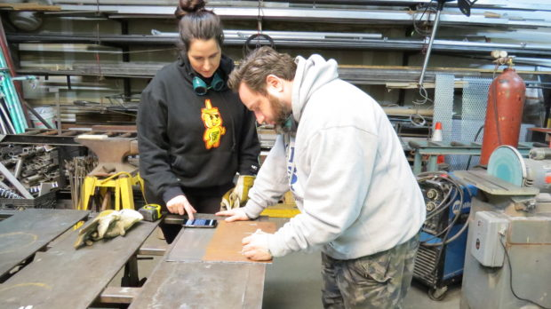 Couples Welding Class: Sketching a design on the metal.