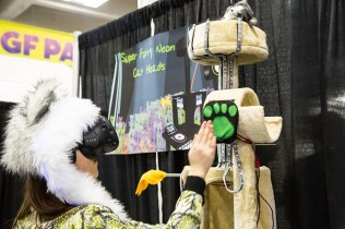 Super Furry Neon Cat Heads is like Dance Dance Revolution meets '90s rave.