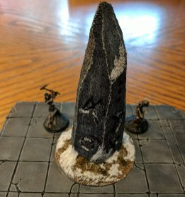 The finished runic stone, being stalked by a couple of Frostgrave skeleton warriors.