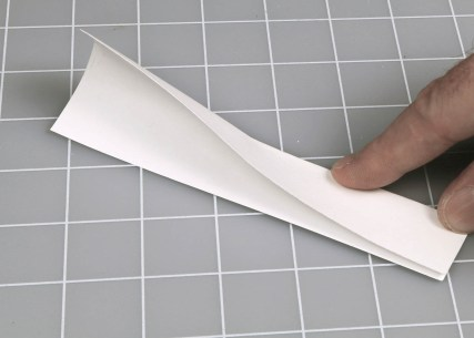 Figure D. After cutting the card, fold it in half lengthwise.