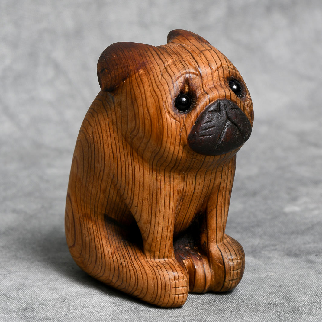 Memorializing a Friend's Passed Pet With a Carved-Wood Pug