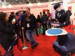 A robot demonstrating the capacity for pizza slinging movements drew crowds