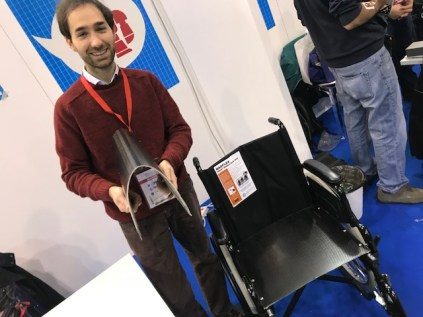 A material designed to be flexible on one side, but rigid on the other. Good for wheelchair application: the seat can still fold, but the user is supported