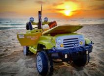 Datadrianconverted an old power wheels vehicle to hang out with him at the beach.
