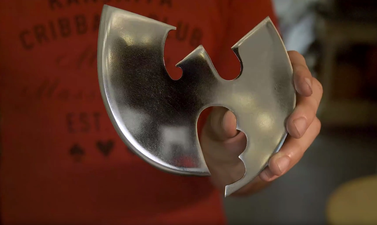 A Wu Tang Pizza Cutter from a Saw Blade