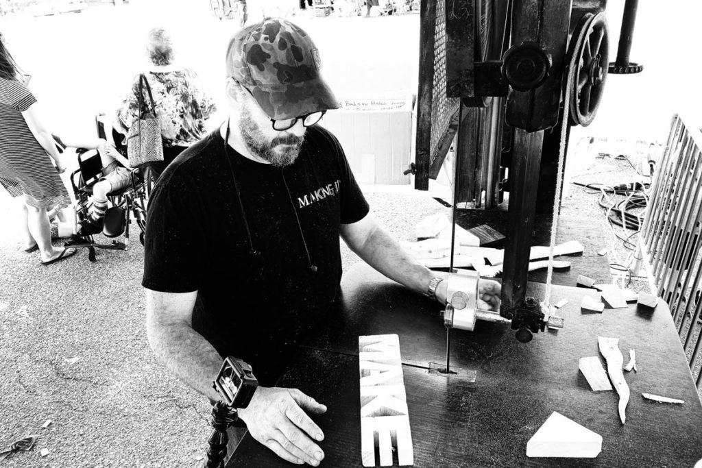 Jimmy DiResta carving the letters MAKE on a bandsaw