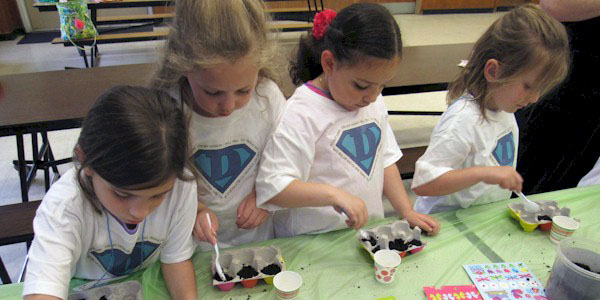 Daisy Girl Scouts planting seeds