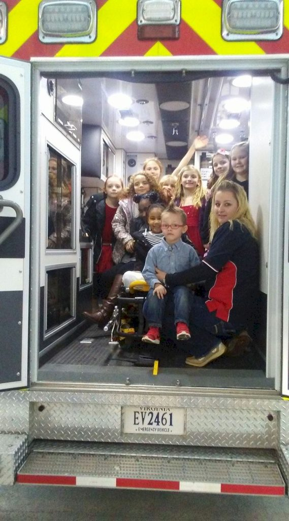 Girl Scouts check out an ambulance.