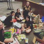 Girl Scouts doing a school supply drive.