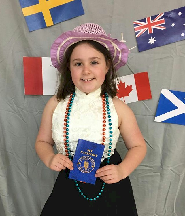 Girl Scout with passport at Thinking Day.