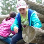 Brownie Girl Scout Climbing on Logs
