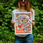 girl holding a map of asheville