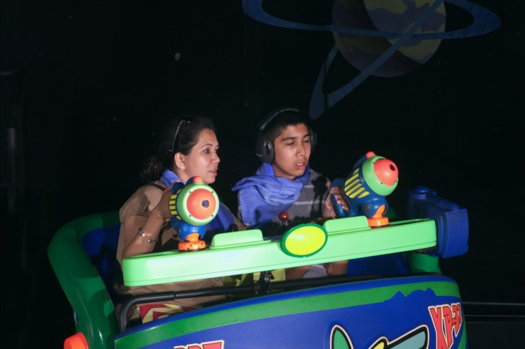 """My mom and Mysoon in """"Toy Story Midway Mania"""" (A very LOUD ride)"""
