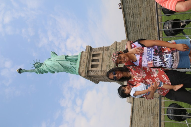 With my cousins in front of the Statue of Liberty