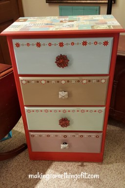 . . . plus some pretty new hardware and scrapbook paper remnants Mod Podged to the top of it, and created something I really love!