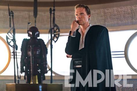 Mandalorian armor lurks behind Bettany in NEW Solo: A Star Wars Story photo