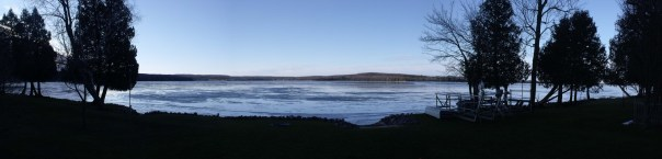 A panoramic view of the lake - you can see the ice on the lake.