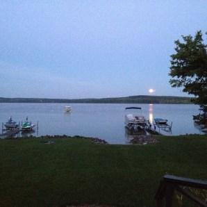 the moon slips down across the lake