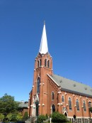 a silver spire in a clear blue sky