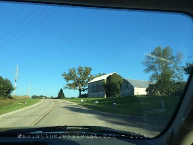 the open road, a barn, and an endless blue sky