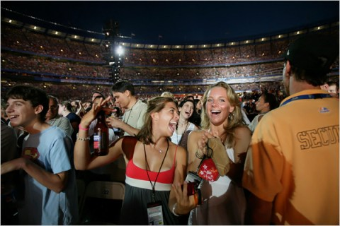 Crazed fans at sold out music concert