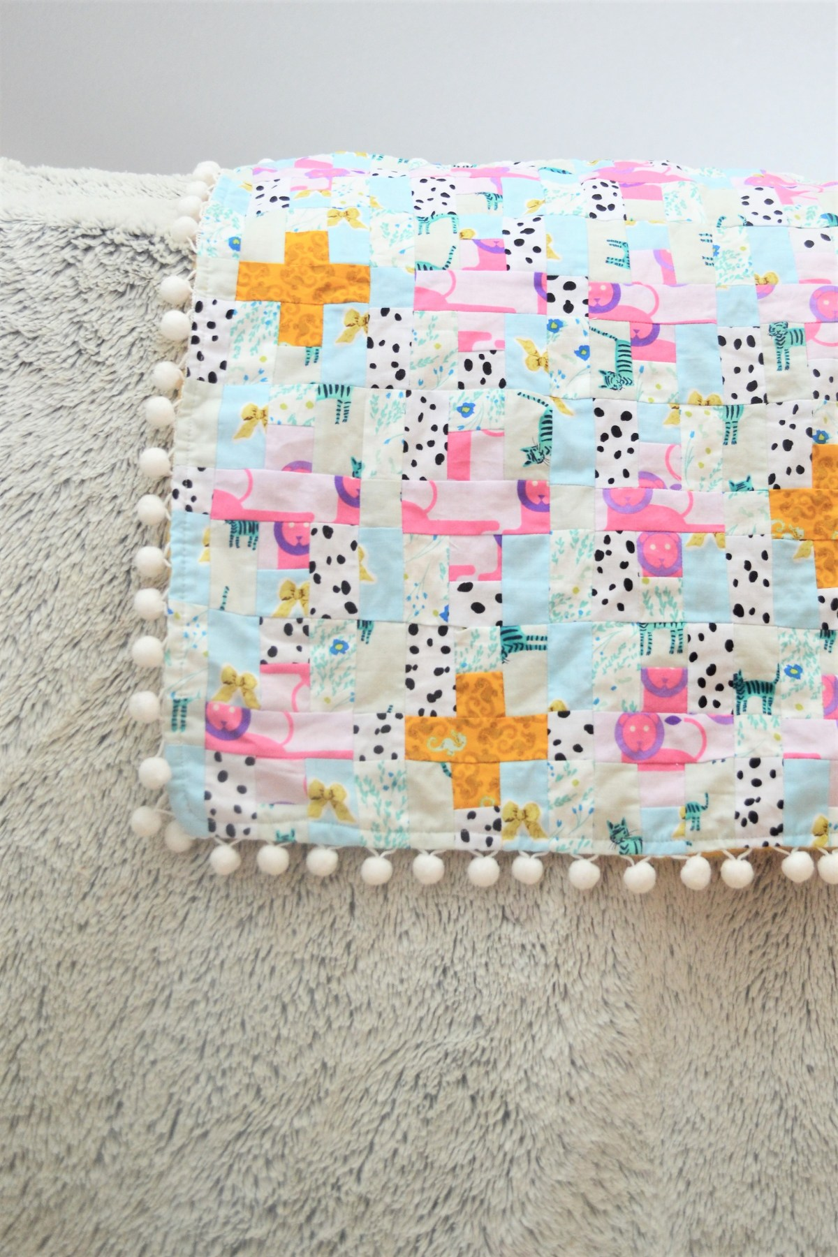 How to Add Pompom Trim to a Quilt - compleated
