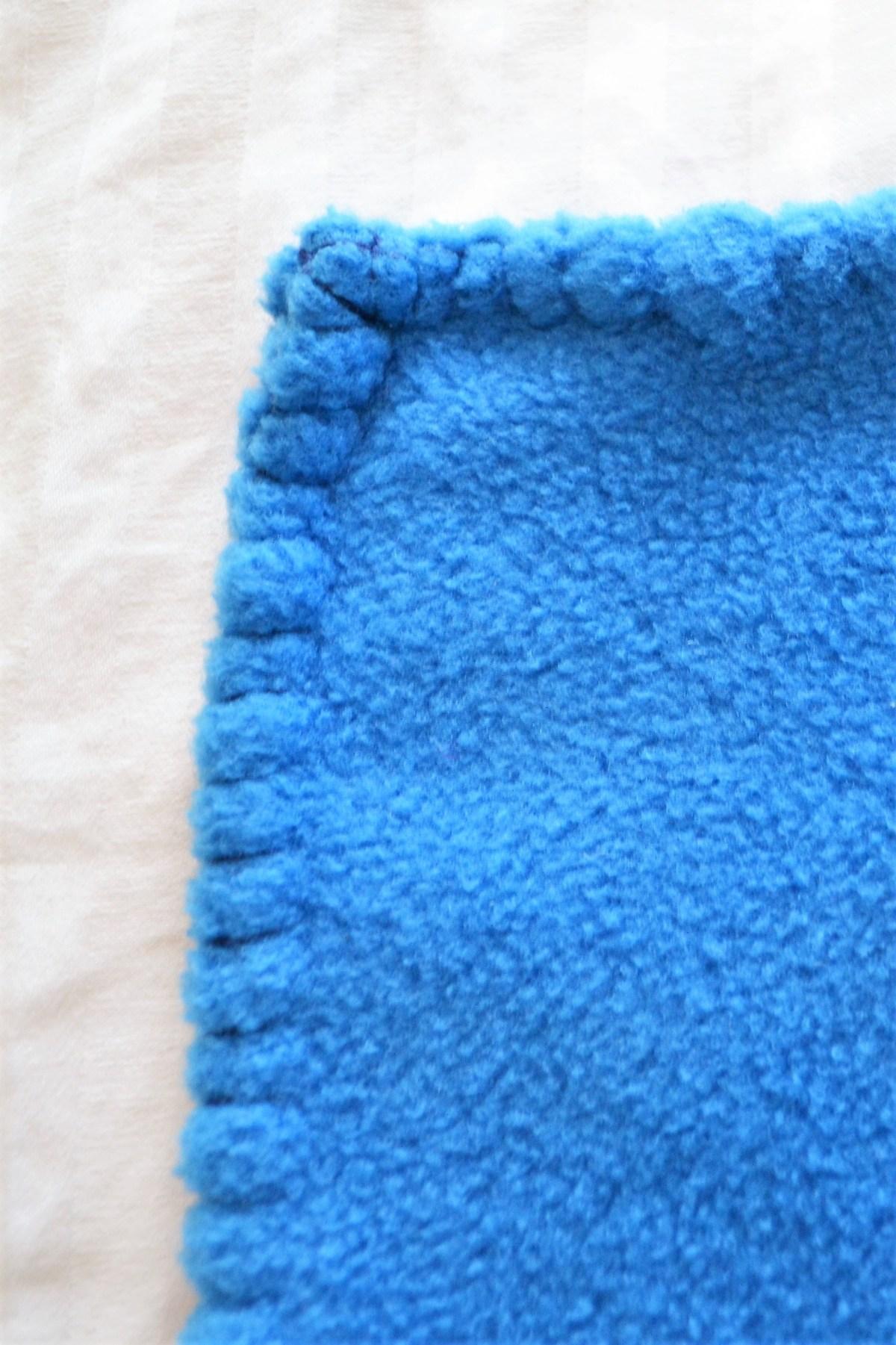 Hand Sewn Fleece Toddler Blanket Tutorial! - The Blanket Stitch! - stitched corner