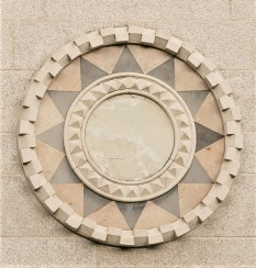 Portland Stone framed roundel with central disc of Connemara Marble and triangular sections of Carlow black slate and yellow chalf limestone from Antrim
