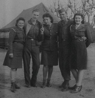 I am second on left with a buddy and three French women, November 16, 1945