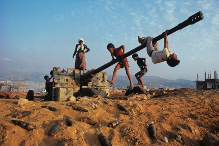 Steve McCurry,Muslim children clamber over an abandoned anti-aircraft gun near Beirut, Lebanon, 1982