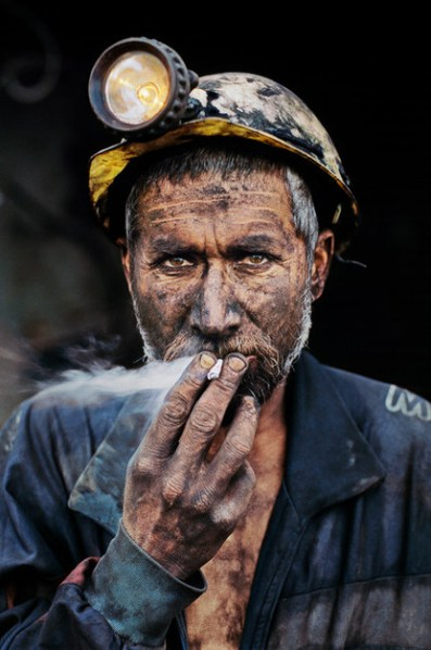 Steve McCurry,AFGHANISTAN. Pul i Khumri. 2002. Coal Miner smoking a cigarette.