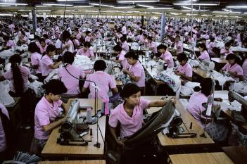 Steve McCurry,BURMA. Rangoon. 1994. Women in a clothing factory.