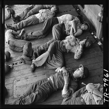 lossy-page1-600px-Enlisted_men_exhausted_after_more_than_24_hours_at_general_quarters_sleep_in_tangled_patterns_aboard_the_USS..._-_NARA_-_520905.tif