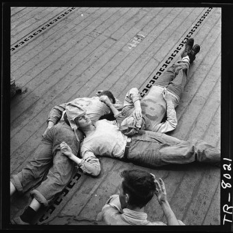 lossy-page1-600px-Sailors_sleeping_on_flight_deck_of_the_USS_Lexington_CV-16._-_NARA_-_520899.tif