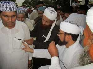 Shaykh Muhammad Tahir Bakhshi Naqshbandi Mujaddidi teaching the dhikr to a new seeker