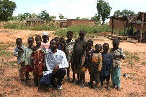 UC Davis collaborator Abou with children in Sidarebougou. Image courtesy of the Vector Genetics Lab at UC Davis.